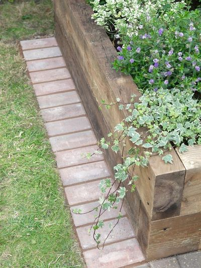 Learn how to install a strip of bricks that will help to make cutting the grass easier with these landscaping tips from DIYNetwork.com.