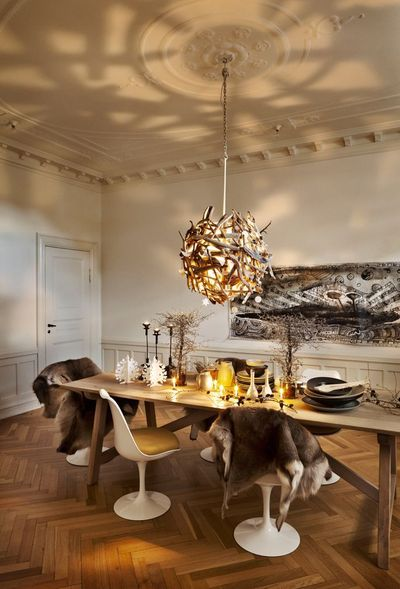 natural driftwood chandelier and a modern interior. love the shadows.