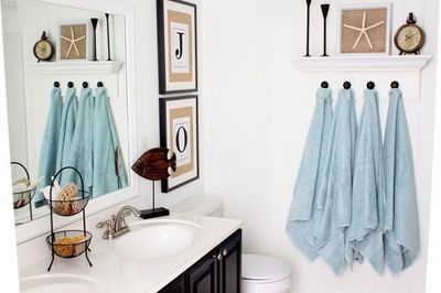 Inspiration for a someday camp bathroom....but more rustic. Tans, dark bronze, watery blue, woven grass rug, white beadboard with pale color up high, etc.
