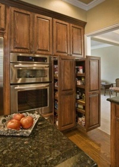 Kitchen cabinets.....lighter color; love cabinets & pull out pantry doors