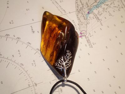 Pendant from a large lump of Baltic amber hung on a silver tie. Exquisite gift for any occasion �'�50.00