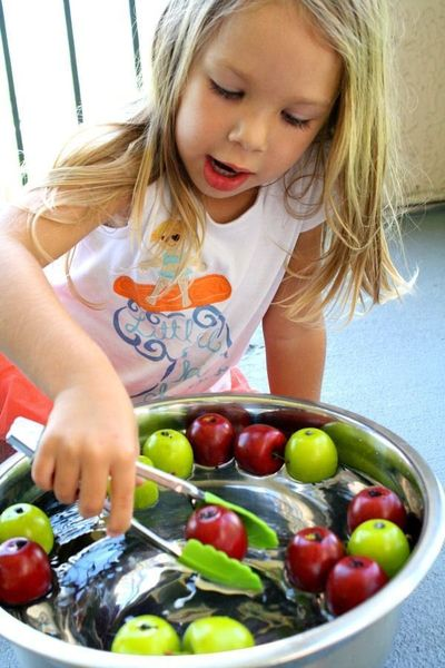 """Practice fine motor skills and enjoy some water play with this fun """"bobbing"""" for apples fall activity for toddlers and preschoolers."""