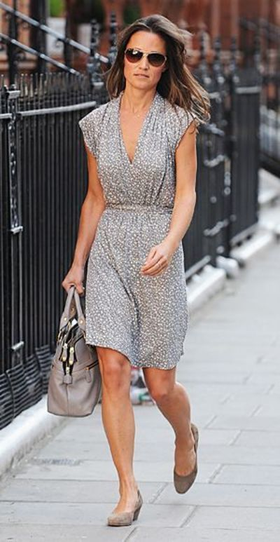 For the first time since the Royal Wedding weekend, Pippa was spotted in public, wearing a summery dress by French Connection and brown wedges while shopping in London.