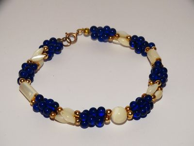 Mother Of Pearl Cobalt Blue Plastic Or Lucite Bead Bracelet. $15.00