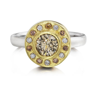 Round Brilliant cut natural fancy brown diamond halo ring, 6.25 mm, .94 carats White diamonds, 7 1.5 mm diameter, .11 carats Brown diamonds, 7 1.5 mm diameter, .11 carats 18 karat yellow gold top with burnish set diamonds 14 karat white gold band. To know...