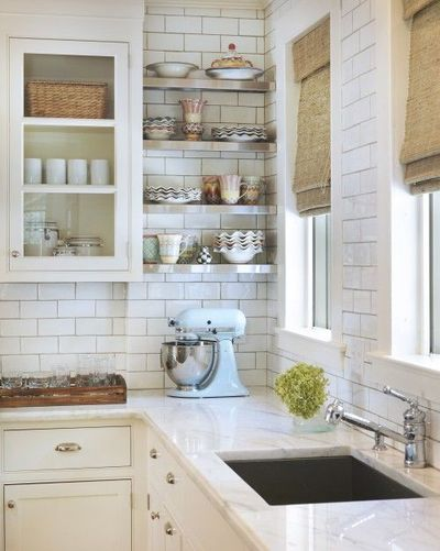 white kitchen cabinets, white kitchens and marble countertops.
