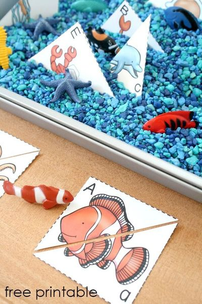 Use this free printable matching game to set up your own easy ocean theme ABC sensory bin for preschoolers
