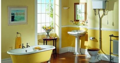 yellow bathroom with darker yellow below.