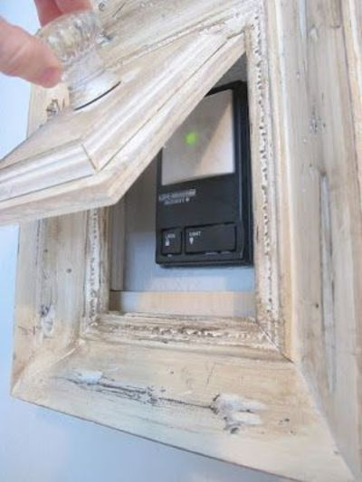 How to turn a picture frame into a gadget to hide your garage door opener.