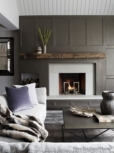 I am frequently torn on fireplaces. Today I love vintage mantles and brick. Tomorrow- something ultra modern like this. It sort of reminds me of Beetlejuice.... I do especially love the chunky wood mantle.