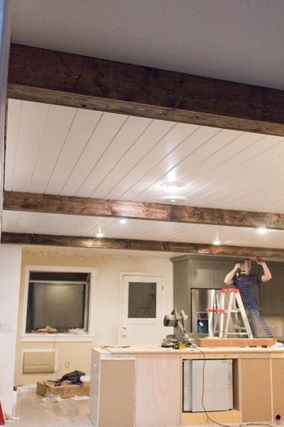 DIY Faux Wood Beams ... really cool idea how she made them and saved costs ... she put them in her kitchen .... then later put them in her bedroom .................. #DIY