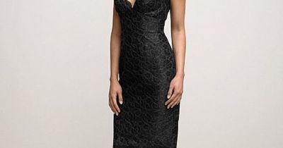 lace dress over black lining with cap sleeves, above the knee length skirt and open keyhole back.