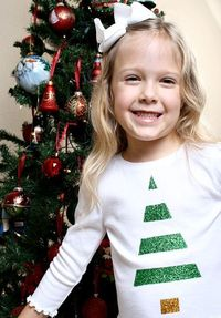 Use fabric glitter to create these adorable and easy holiday shirts for kids to wear to holiday events.