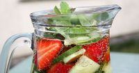 sparkling water with strawberries and cucumbers