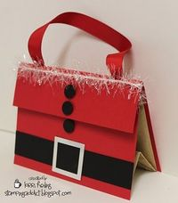 "This is a simple little gift bag decorated to look like Santa. The bag is just a basic brown paper lunch sack. Here are some dimensions for you: Back red cardstock piece is 5 1/2 x 6 1/4. The 5 1/2"" side is scored at 2"" and that will make the fl..."