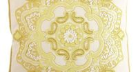 beading. Made of cotton linen with a corded trim, the pillow reverses to solid yellow.       ...