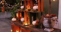 Simple Fall Decorating Idea: Nested crates and pottery pumpkins on two weathered boards-- with LED candles and string lights. Pick up more holiday inspiration from designer Melissa Valeriote... on The Home Depot Blog. ||