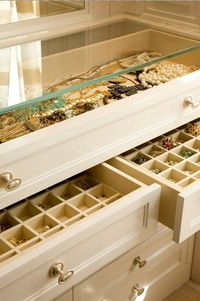 Build this from an old dresser. Remove top and replace with glass and fill top two drawers with organizers. Great idea.