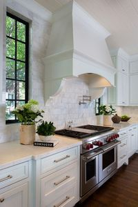 white kitchens, black window frames and stove hoods.