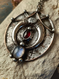 Brass pendant with crescent moon and natural stone- granat and moonstone, ethnic pendant, shamans jewelry $63.00