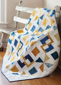 Semaphore from Easy Quilts Fall 2013 is a throw size quilt featuring pinwheel and square quilt blocks. Quilt by Marie Bostwick.