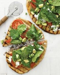 Grilled pizzas topped with avocado, fresh spinach, and goat cheese are a California dream come true.
