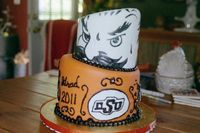 OSU graduation cake. This was my first topsy-turvy cake, too. I painted Pistol Pete on the top tier.