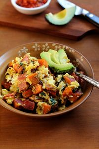 Hearty and nutritious scrambled eggs with sweet potato, bacon, and spinach. An easy breakfast recipe that keeps you full and satisfied. Howdy, how was your week