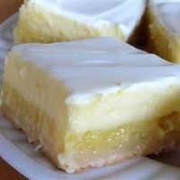 Cheesecake Lemon Bars   �€œThis double-layered dessert is not only beautiful, but also delicious. A smooth cheesecake filling sits on top of a light lemony layer to make this the perfect finish to any meal.�€