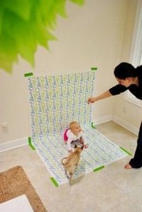 Use wrapping paper as a photographic backdrop for baby pictures. I wish I would have thought of that.