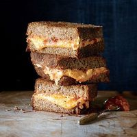 We love the combo of grilled cheese sandwiches and roasted tomato soup--so why not combine the two in each ooey-gooey bite?