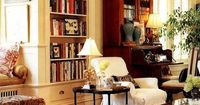 cozy living room filled with books and antiques
