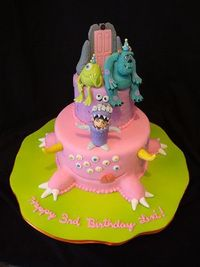 Fondant covered cake with gumpaste hand-sculpted figures.