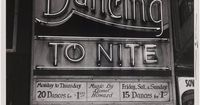 Vintage photo showing an old sign for a dance hall. 20 dances fir $1, Music by Lionel Howard.