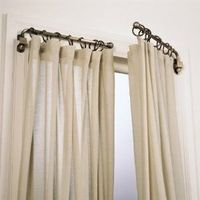 Replace your curtain rods with swing arm rods to open up the room and allow more light in. Windows will appear to be bigger!
