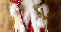 Adorable! I love fur or feather boa's, felt, ornament face.....I see another inspirational piece to be made......