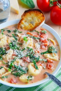 A creamy tomato soup with cheese tortellini, spinach and plenty of parmesan cheese that is pure comfort food on a chilly day!