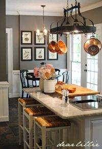 copper cookware and gray walls