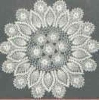 Crochet pattern for a rose and pineapple doily.