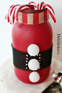 Combine a Mason jar, red chalky paint and a few trimmings and you get this cute Christmas candy cane jar. See the tutorial on Debbiedoo's. ||
