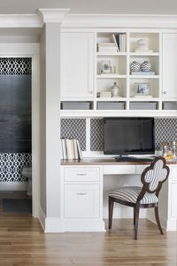 Great use of a corner for extra storage and a small office space by Martha O'Hara Interiors