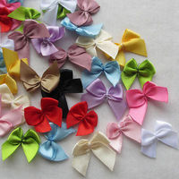 Pack of 200 Mini Ribbon Bow Appliques. Different Colours . Clothing and Xmas Embellishment Crafts £5.89