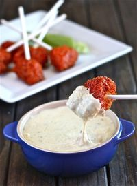 This Buffalo Chicken Lollipop Wwith Blue Cheese Fondue Recipe is a creative and fun new way to enjoy the classic flavors of buffalo and blue cheese.