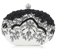 White Clutch with Black Beads $79.00