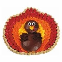 They'll Gobble It Up Pie. Serve a rare bird this Thanksgiving. Top a pumpkin pie with a turkey shaped from pastry shapes cut with our medium and large round cutters from our 101-Piece Cookie Cutters Set. Surround the turkey with piped-on feathers crea...