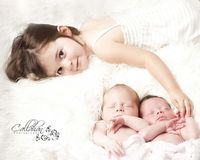 newborn twins with sibling pose