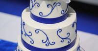 Royal blue and white swirl wedding cake