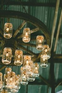 would love to have this mason jar/wagon wheel chandelier in a finished barn!