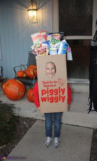 Debbie: My 7 year old daughter Jessica is wearing her Piggly Wiggly grocery bag. This is one of the local food chains in our area. I took a box and cut...
