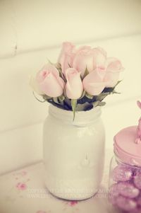 Beautiful way to display flowers at your next baby shower. Paint a mason jar! Via Kara's Party Ideas
